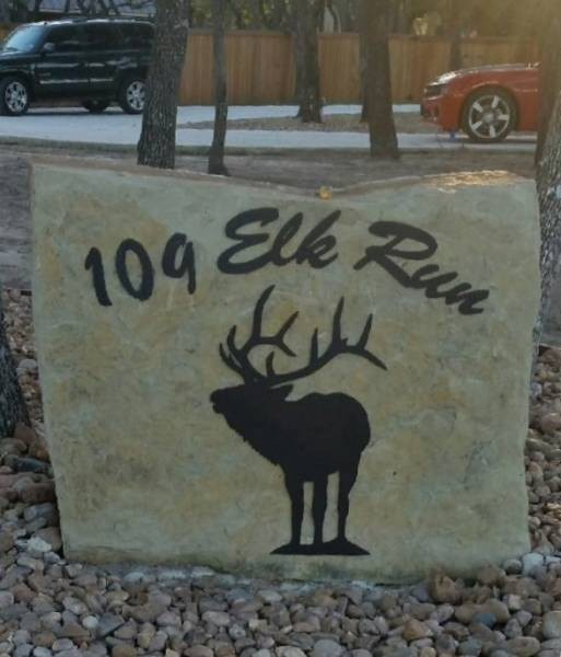 Rock sign with street address