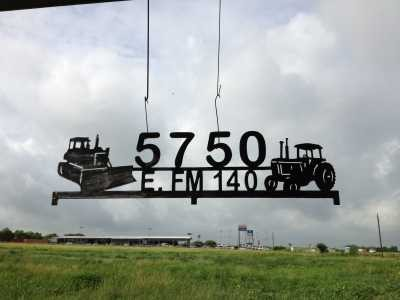 Gate sign with Tractor and Dozer