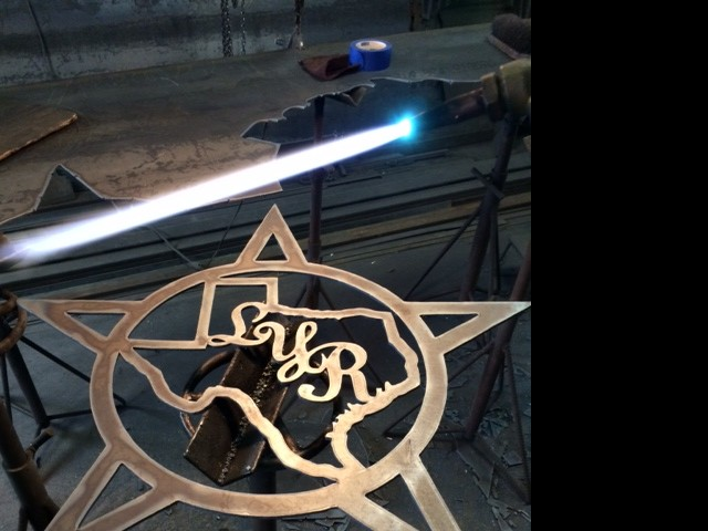 Ranch sign with Texas state outline and star